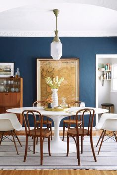 Navy dining room with Saarinen tulip table and bentwood chairs.