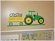 This personalized tractor wall appeal is an example of a multi-color vinyl installation in a child's bedroom.