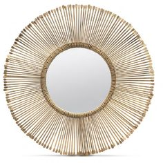 Thin metal rods wrap a central mirror and terminate with a slight flare. The Dawn creates a new interpretation of the sun mirror! #madegoods #shopcandelabra