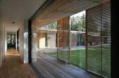 Modern House with Glass Atrium Sliding Door Shutters, Wooden Sliding Doors, Front Doors, Sliding Panels, Entry Doors, Indoor Outdoor, Outdoor Living, Slat Wall, Patio Roof