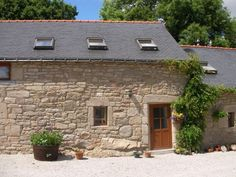 Ty Megan, Lovely Stone Cottage with Play Barn & Pool. Ty Megan is set within a small traditional hamlet of stone cottages which have been sympathetically restored to form 4 charming but well equipped holiday cottages. The converted granite cow barns now feature exposed wooden beams, wood floors and log burners. #Brittany #property #cottage #stone #lovely #holiday #pool #rural #enjoy #relax #countryside #view
