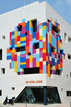 """enochliew: """" Cultural Centre Ca Don José by Hector Luengo Arquitectos The colourful collage above the entrance invites passersby to wander in and discover the latest exhibition, library or event. """""""