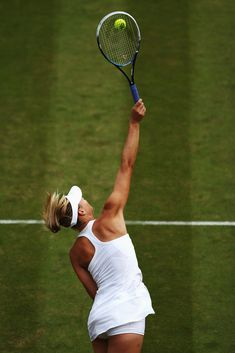 Maria Sharapova Photos: Wimbledon: Day 4. Maria Sharapova of Russia serves during her Ladies' Singles second round match against Timea Bacsinszky of Switzerland on day four of the Wimbledon Lawn Tennis Championships at the All England Lawn Tennis and Croquet Club at Wimbledon on June 26, 2014 in London, England.