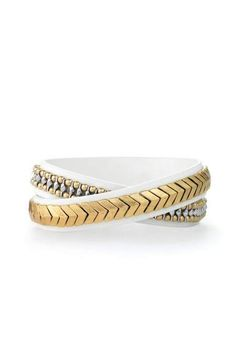 This luxe white leather wrap bracelet has a beautiful semi shiny gold arrow motif. Shop wrap bracelets at Stella & Dot.