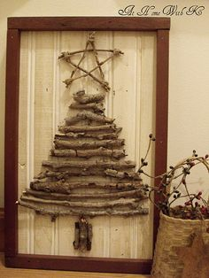 Christmas tree made from twigs...add gold-painted pine cones and acorns for a woodland picture