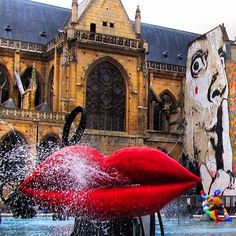 at the end of Centre Pompidou is the wonderfully whimsical Stravinsky Fountain.   Saint-Merri Church as backdrop is a perfect foil for the Shhhhh! mural by Jef Aerosol