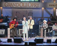 Garth Brooks, Porter Wagoner, Bill Anderson, and Little Jimmy Dickens at the Opry's 80th birthday show.