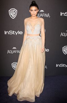 KYLIE JENNER channels her inner Princess Jasmine with a two-piece Labourjoisie gown inset with strategic sheer panels, plus Lorraine Schwartz gems, at the InStyle/Warner Bros. party.