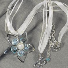 #Aquamarine. 925 #silver, #freshwater #pearl, #organza. Big #flower in 925 silver and petals in shiny aquamarine, central button in #freshwater pearl. #Chocker #necklace in  white #organza and #satin. #Jewel with a #delicate and precious look. #Handmade. Officinagioie, #Italy. - Officinagioie - #Jewelry - #Necklaces - #Silver - #Reputeka