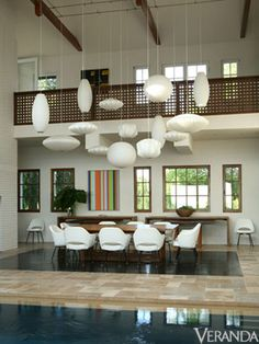 George Nelson Bubble Lights hang at various lengths over a Tucker Robbins table and vintage Saarinen chairs. Saarinen Chair, Nelson Bubble Lamp, Red Rooms, Loft, Interior Decorating, Interior Design, Vintage Chairs, Dining Area, Dining Rooms