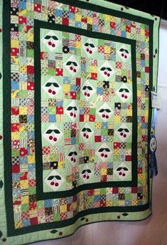 Cute quilt...I'd make the black borders black and white checked squares. I might have to make this one!