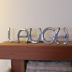 Metal LAUGH Sign, country western decor from horseshoes, wedding or anniversary gift, Made to ORDER via Etsy. Do live laugh love Horseshoe Projects, Horseshoe Crafts, Horseshoe Art, Horseshoe Ideas, Country Western Decor, Rustic Decor, Western Sayings, Country Life, Westerns
