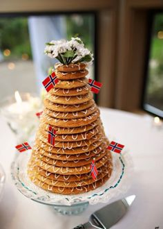 Norwegian kransekake - My sister makes this for various family celebrations. You need the 8 rings to make the 'wreath cake'. It has ground almonds, sugar and egg whites. Norwegian Wedding, Norwegian Food, Beautiful Cakes, Amazing Cakes, Cranberry Wedding, Ground Almonds, Egg Whites, Homeland, Christmas Eve