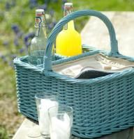 Painted blue wicker picnic basket.