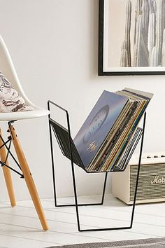 Place this vinyl record rack next to seating in your home to give guests something to flip through.