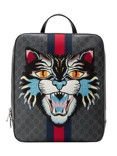 9477b41d33bd For Sale on - The snarling cat head is embroidered and applied to a  structured backpack made in GG Supreme canvas with Web stripe.