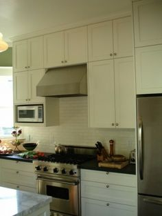 """Make cab. over microwave 15"""" to ? traditional kitchen by Boor Bridges Architecture"""