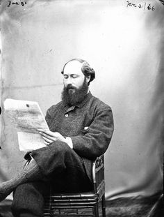 A man identified as Ambrose Congreve reading a newspaper at Clonbrock House, Ahascragh, Co. Galway, Ireland. Image taken January 31, 1866