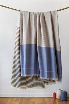 CURRENTLY ON BACK ORDER, Info@studioherron.com for PRE-ORDER.  Our blankets are soft and sturdy works of art for everyday life, comfort  and utility. Inspired by the minimalist paintings of Agnes Martin, each  color and stripe is deliberate and thoughtful. These blankets are made with  100% cotton from a small Virginia fiber farm and custom spun and dyed for  Herron. Each blanket is woven in Chicago in a newly revived artisan weaving  mill on Chicago's Northwest side and stitched by local…