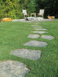 A simple Iron Mountain flagstone path meanders through a lawn to a fire pit area.  Designed and installed by Blessing Landscapes.