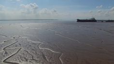 Ship at dock at low tide, Humber Estuary, East Yorkshire, England