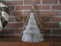 """One """"book"""" tree all dressed up. I purchased the feathery garland from Michael's a few years ago"""