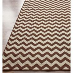i just bought this brown and cream chevron rug for baby jack's room. he just may have a nursery before he turns 1 in a month :)