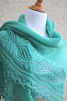 Knit shawl with laced border in mint green color