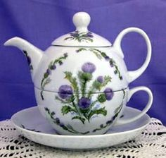 Glamis Thistle is a classic pattern that is always popular. The distinct purple flowers are bold and bright, and are a lovely accent if combined with other patterns.   This teapot is made of fine porcelain and hand decorated in the USA.