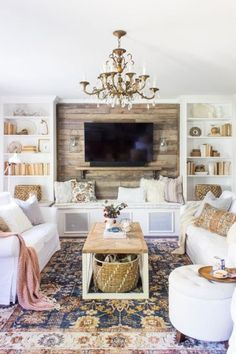 f65c6545411 02 A Bright Eclectic Space With Rustic Touches And Two White Sofa  Accessorized With Pastel Pillows