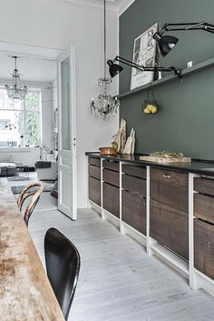 green kitchen wall, rustic cabinet doors, clamp lamps