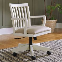 The Sarvanny home office desk chair rolls out the best in cottage chic charm. Wood frame with a classic slat back design is complemented by a farmhouse cream finish so fresh and clean. Generously cushioned seat, upholstered in a plush microfiber, raises your comfort level, while adjustable height design, casters and swivel function work with your every move. Ashley Sarvanny Cream Two-Tone Swivel Desk Chair | Weekends Only Furniture and Mattress