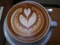 """A latte (from the Italian caffelatte, meaning """"coffee and milk"""") is a type of coffee drink made with hot milk.You know art is everywhere and with the help of Coffee Type, Coffee Art, My Coffee, Coffee Drinks, Coffee Shop, Coffee Health, Latte Art, Mind Blown, Mocha"""