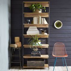 """The Rustic Modular 33"""" Bookshelf works everywhere from the living room to the dining room or home office. Supported by blackened steel frames, each piece is subtly unique, due to the natural color variations in the mango wood."""