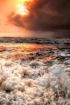 this photo the sunlight helps provide contrast to the foaming waters below. We have this nice orange sunlight coming through the clouds but all around it is surrounded by colder colours and tones. Sea And Ocean, Ocean Beach, Ocean Waves, Ocean Sunset, Beautiful World, Beautiful Places, Beautiful Pictures, All Nature, Amazing Nature