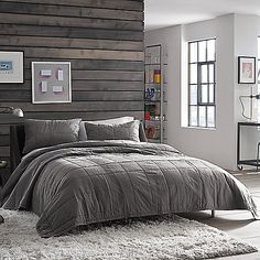 Add texture and dimension to your bed with the sophisticated Kenneth Cole Reaction Home Reflections Coverlet. Adorned with a square block pattern on a gunmetal-colored ground, the bedding makes the perfect layering piece to any bedding ensemble.