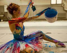 Ballerina covered in paint