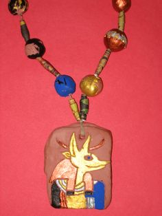 4th grade Ancient Egyptian style terra-cotta clay necklace with clay and paper beads; art teacher: Susan Joe