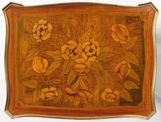 c1765 A Louis XV ormolu-mounted tulipwood, amaranth, marquetry and parquetry table en chiffonière circa 1765, stamped J. Birckle JME 15,000 — 25,000 USD. Unsold