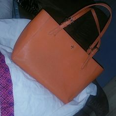 BEAUTIFUL! Tory Burch Orange Hard Leather Purse LADIES!! This is a gorgeous Tory Burch bag that is an orange leather. It has 2 small blemishes (pic 2 & 3) that may come out with leather cleaner. Also, has some makeup stains in bottom (pic 4). I had to show the defects, but honestly, they're so minor when carrying this beautiful bag! This was given to me by my mother, but I won't carry it, and it deserves to be shown off! It does come with the duster as well. Tory Burch Bags Shoulder Bags