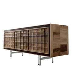 This elegant piece of furniture features three doors and two internal compartments and glass shelves. It is made in walnut wood fillet with three front.