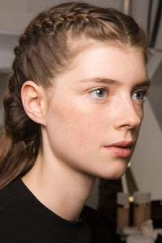 Not-So-Basic Braids: Two French braids were weaved tightly near the hairline, but secured very loosely toward the back.