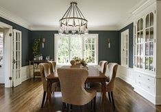 classic dining room, dark walls + wainscot, mod fixture