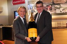 """Both Giants in their industries, Ferrari and Veuve Clicquot have announced a partnership recently. The two will collaborate in special events that range from classic car events, racing spectaculars, new model launches for Ferrari and other lifestyle events to follow. The design teams at Ferrari and Veuve also plan on """"innovating extraordinary and celebratory new creations,"""" according to a joint statement issued at the Monaco Grand Prix just a couple of weeks ago."""