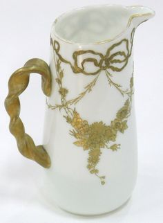 Mt. Washington Colonial Ware with Twisted Gold Handle and a Gold Floral Swag Decoration - 10 Inch HOA - Signed with Red  Wreath and Numbered 1025.