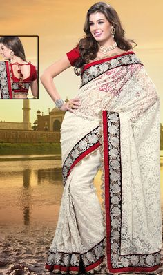 Different colors are a perfect blend of traditional Indian heritage and contemporary artwork.   This off white net saree is nicely designed with embroidered patch work is done with resham, zari, stone and lace work.   Beautiful embroidery work on saree make attractive to impress all.   This saree gives you a modern and different look in fabulous style.   Contrasting red blouse is available.   Slight color variations are possible due to differing screen and photograph resolution.