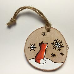 A personal favourite from my Etsy shop https://www.etsy.com/listing/256564694/fox-christmas-ornament-handmade-wood