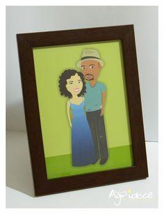 Criação da ilustração personalizada do casal + impressão + moldura marrom com vidro. <br>Tamanho do quadro: 16 x 20 cm.