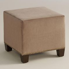 Velvet Ottoman??? From Cost Plus, comes in linen, velvet, micro suede and a bunch of colors.