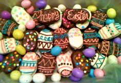 I made these Easter cookies by making peanut butter sandwiches out of townhouse crackers and dipping them in melted almond bark. Then I colored and piped the designs! So fun and delicious!